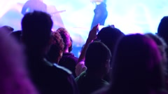 Spectator shooting video via cell phone camera of a concert performance Stock Footage