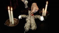 Voodoo doll candles hammer nails ritual Stock Footage