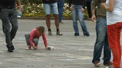 Little girl drawing with chalk on Konigstrasse, Stuttgart Stock Footage