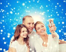 happy family with camera at home - stock photo