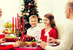 Smiling family having holiday dinner at home Stock Photos