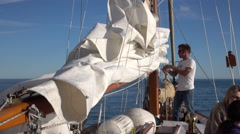 Bringing Down The Main Sail On A Traditional Ketch Yacht Stock Footage