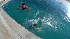 Toddler jumps swims and plays with his auntie Stock Footage