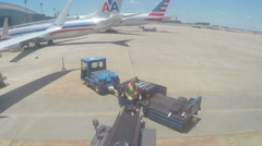 Off loading baggage from plane Stock Footage
