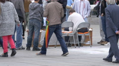 Two men playing chess and other people watching and passing by, Stuttgart Stock Footage