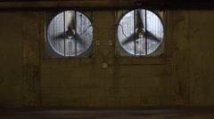 Industrial Ventilation Fans In An Underground Parking Garage Stock Footage
