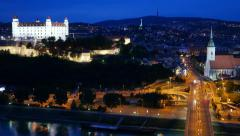Bratislava, Slovakia. Night view of old castle and old town. UHD, 4K - stock footage