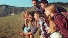 Handheld shot of friends taking selfie in nature Stock Footage