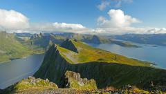 Senja island, Norway. Landscape with mountains, fjord and clouds. Time lapse Stock Footage