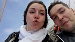 Two people make selfie on the big hight in the amusement park. - stock footage