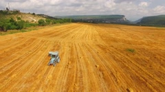Tractor Baler Driving Along Yellow Wheat Field Stock Footage