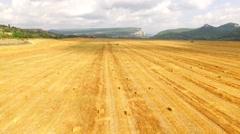 Golden Stubble Field At Picturesque Terrain Stock Footage