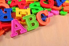 Colored plastic alphabet letters ABC - stock photo
