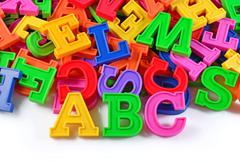 Plastic colored alphabet letters ABC - stock photo