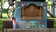 Retro french singer singing & playing barrel organ in public park - barrel organ Stock Footage