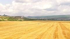 Stubble Wheat Field At Beautiful Hilly Terrain - stock footage