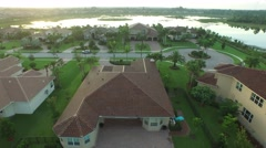 Landing in backyard of 7717 Eden Ridge Way West Palm Beach, FL Stock Footage