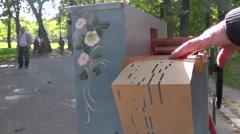 Retro french singer singing & playing barrel organ in public park - long Stock Footage