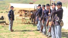Civilian reenactors being trained to use rifle Stock Footage