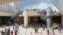 Louvre Pyramid from the inside of the museum Stock Footage