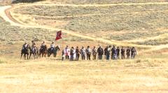 Civilian reenactors marching in battlefield Stock Footage