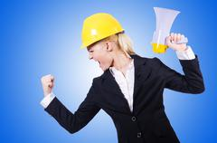 Female construction worker with loudspeaker Stock Photos