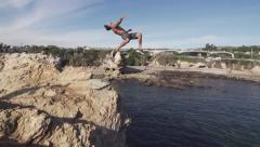 Gainer Cliff Jump Slow Motion into Ocean Stock Footage