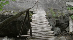 Wooden bridge over a mountain river. - stock footage
