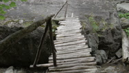 Stock Video Footage of Wooden bridge over a mountain river.