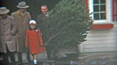 1953: Dad shows off this years Christmas tree with family. Stock Footage
