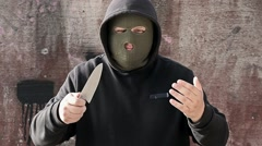 Aggressive man with knife call for fight Stock Footage