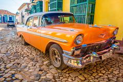TRINIDAD, CUBA - SEPTEMBER 8, 2015: Old American cars used everyday due to Stock Photos