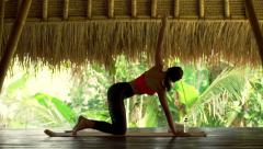 Young woman exercising, stretching on mat in gym Stock Footage