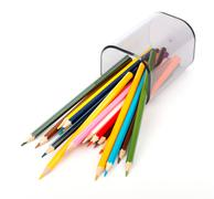 Fallen pencil cup with crayons Stock Photos
