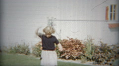 1953: Young girl playing outdoors with Yo Yo toy. Stock Footage