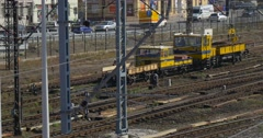 Worker in Orange Workwear on Railroad Yellow Locomotive is Moving Slowly by Stock Footage