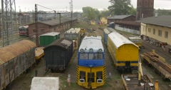 Freight Trains at Railroad Railway Station Front Windows Buildings Towers Wires Stock Footage