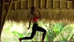 Young woman doing lunge exercise on mat in gym Stock Footage