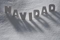 White Word Navidad Means Christmas On Snow, Snowflakes Stock Photos