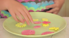 Close up of kids' hands making colorfull cookies Stock Footage