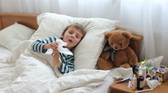 Sick child boy lying in bed with a fever, resting - stock footage