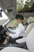 Professional woman driver at the wheel of her vehicle Stock Photos