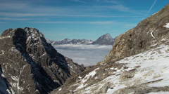 Timelapse - Swiss Alps with a fog /cloud layer. Stock Footage