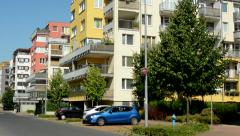 Some cars stand before the prefab houses in the housing estate Stock Footage