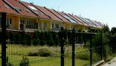New estate houses with small gardens in the tranquil landscape Stock Footage