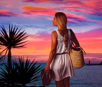 Blond girl sunset Andratx Mallorca port sunset - stock photo