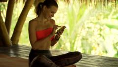 Young sportswoman with smartphone lying sit in outdoor gym Stock Footage