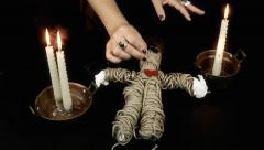 Voodoo doll candles ritual front Stock Footage