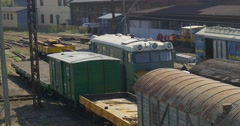 Workers Men in Orange Workwear at The Trains Freight Trains Platforms Wagons - stock footage