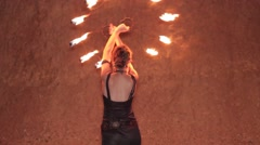 Girl dancing with fire fan Stock Footage